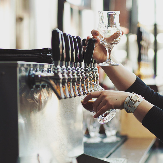 Woman pouring draft beers for tasting event at the Yards DC