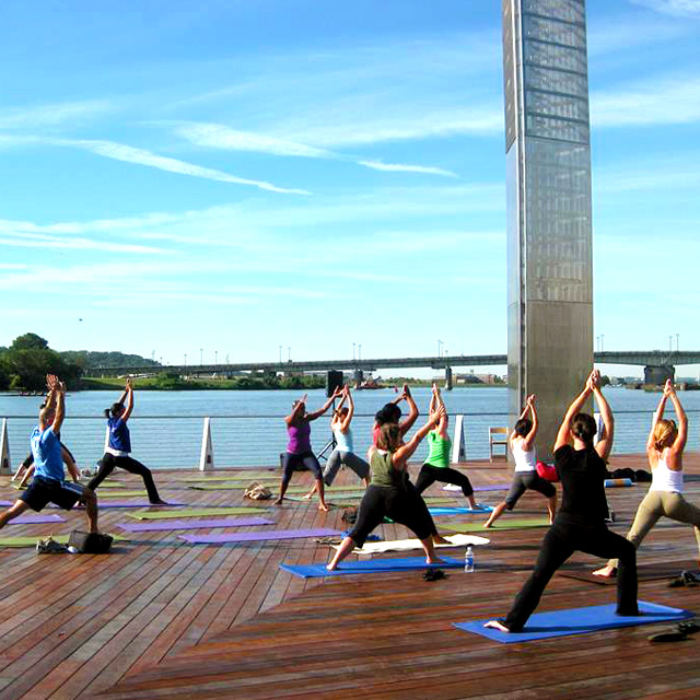 Outdoor yoga class on the Anacostia riverfront