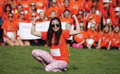Woman posing in front of crowd at the walk for MS in DC