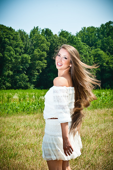 Sara Gray musician in field with wind blowing her hair back