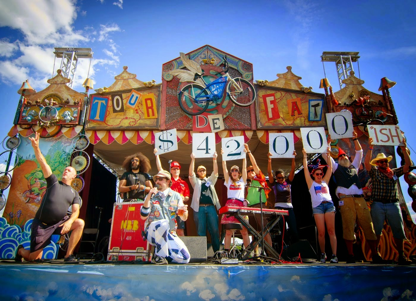 Group presents money raised by the New Belgium Tour de Fat bike race on stage at the Yards DC