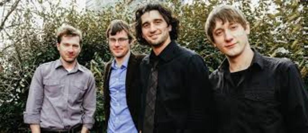 Band posing outdoors