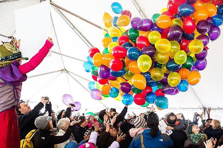 Big stack of balloons inside of tent at a family friendly New Years event in DC