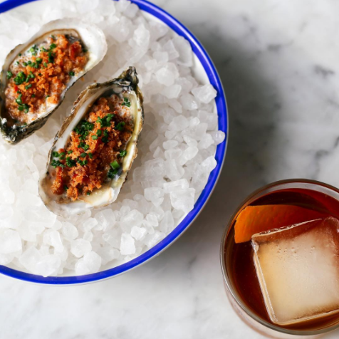Upscale seafood with whiskey on the rocks prepared at a waterfront restaurant