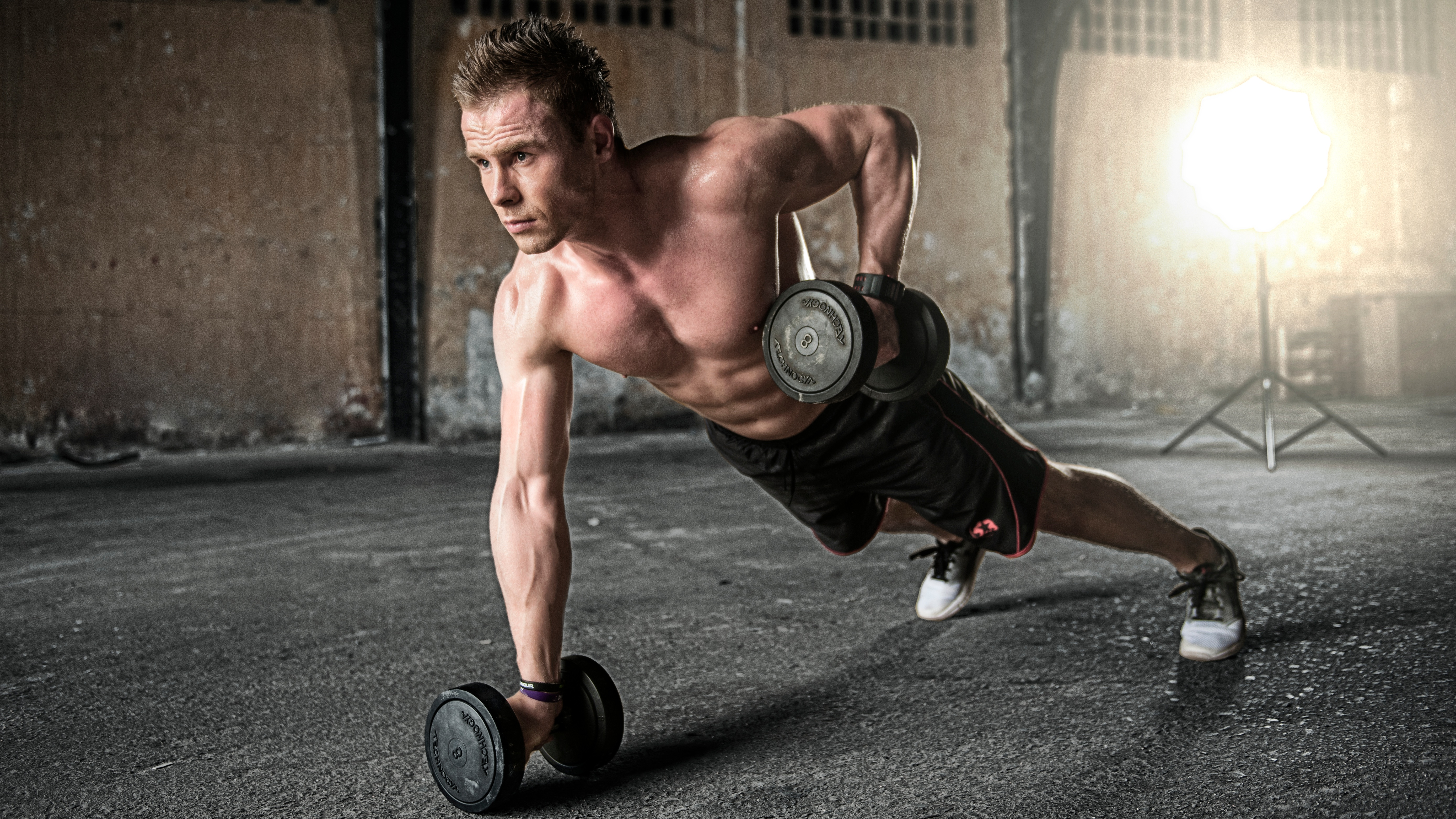 Man working out in athletic shorts and sneakers