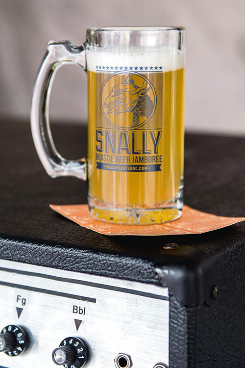Large mug of beer on top of an amp