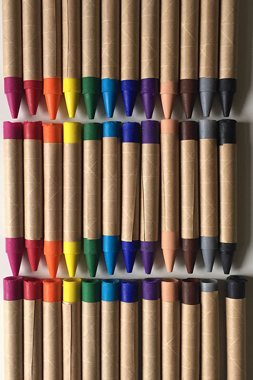 Colorful crayons on a table during a children's crafting event
