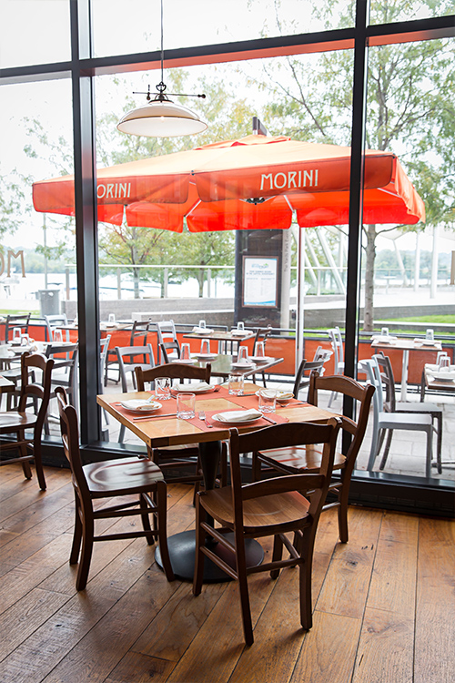 Outdoor seating and interior at the Osteria Morini restaurant in DC