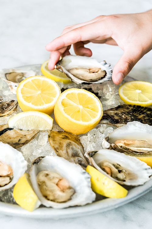 Fresh oysters and lemon at a seafood event in Anacostia