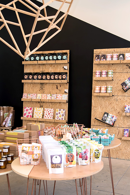 Interior of storefront for paper products, granola, tea, and candles