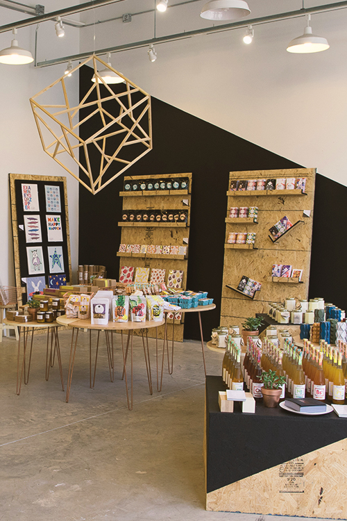 Modern store interior in Washington DC selling teas, candles, blankets, womenswear, paper goods, and more