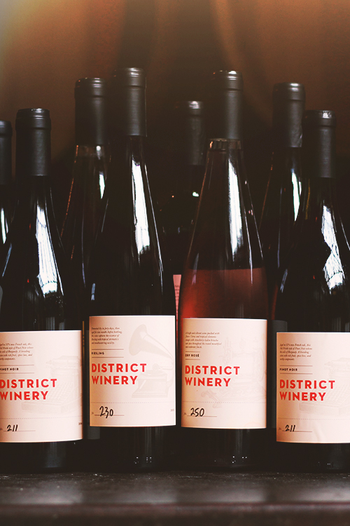 District Winery bottles of Pinot Noir, Riesling, and Dry Rosé