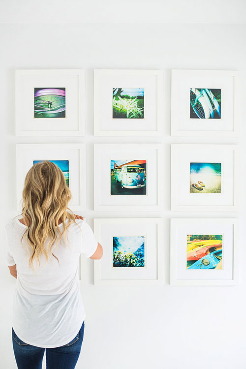 Woman looking at photos in art gallery exhibit in DC