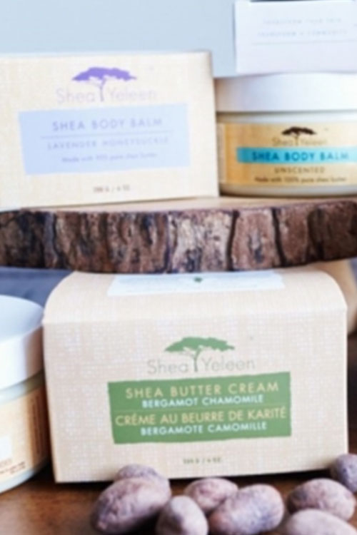 Shea butter cream in boxes and bottles at a sampling event for natural products