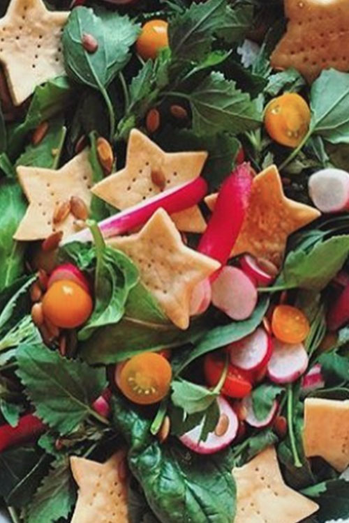 Festive holiday salad with star shaped crackers