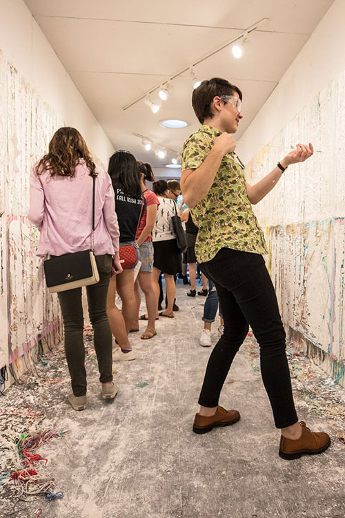 Interactive art experience - group of people painting on white walls