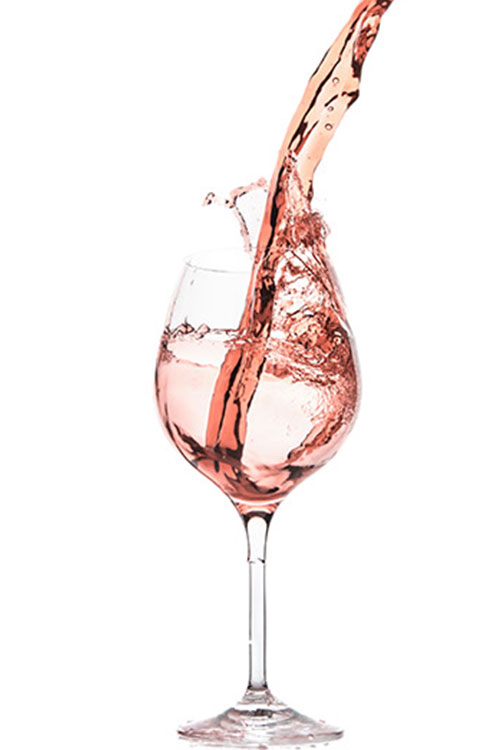 Rosé wine being poured into glass