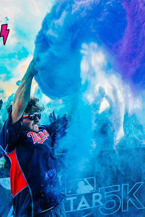 Twins Baseball fans celebrating with colored powder