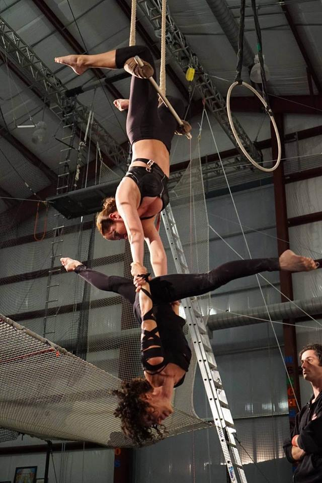 Women doing a trapeze class together with instructor