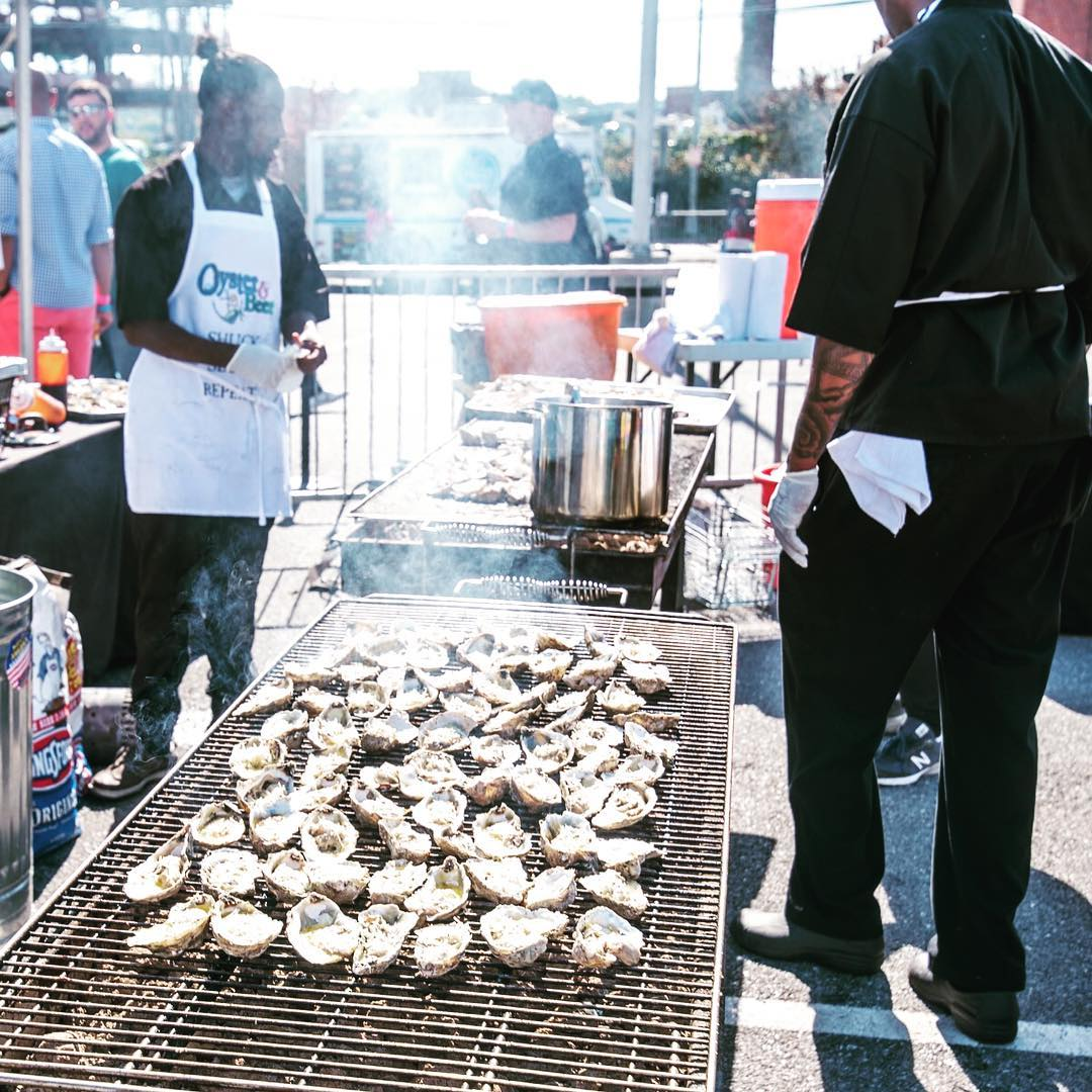 Oysters being grilled outside during a festival event in DC