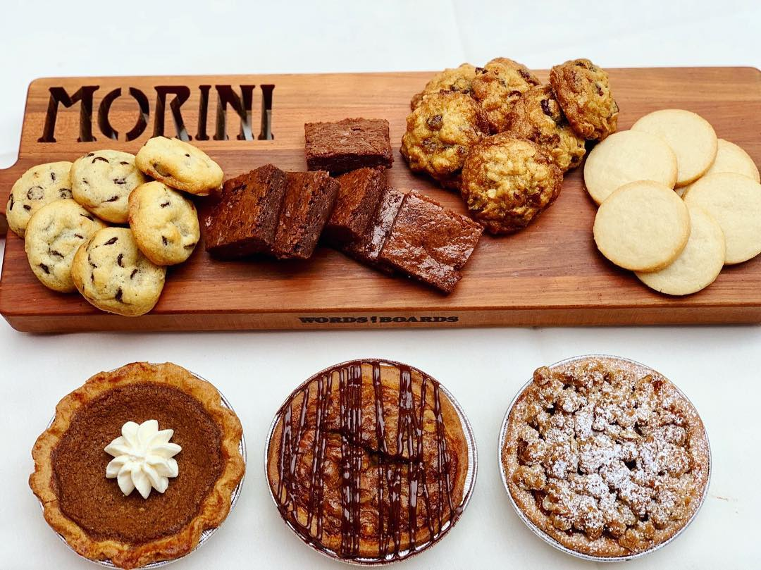 Multiple baked goods lying on a Morini cutting board