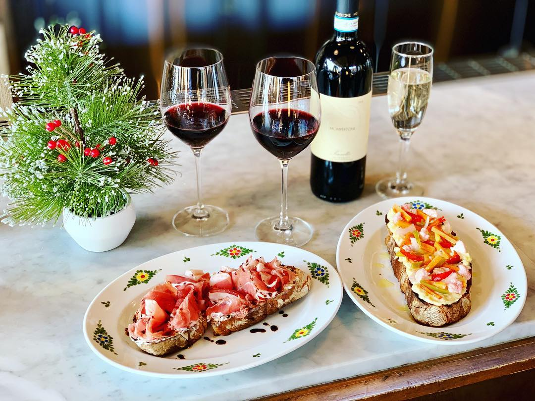 Crostini and red wine in a holiday place setting