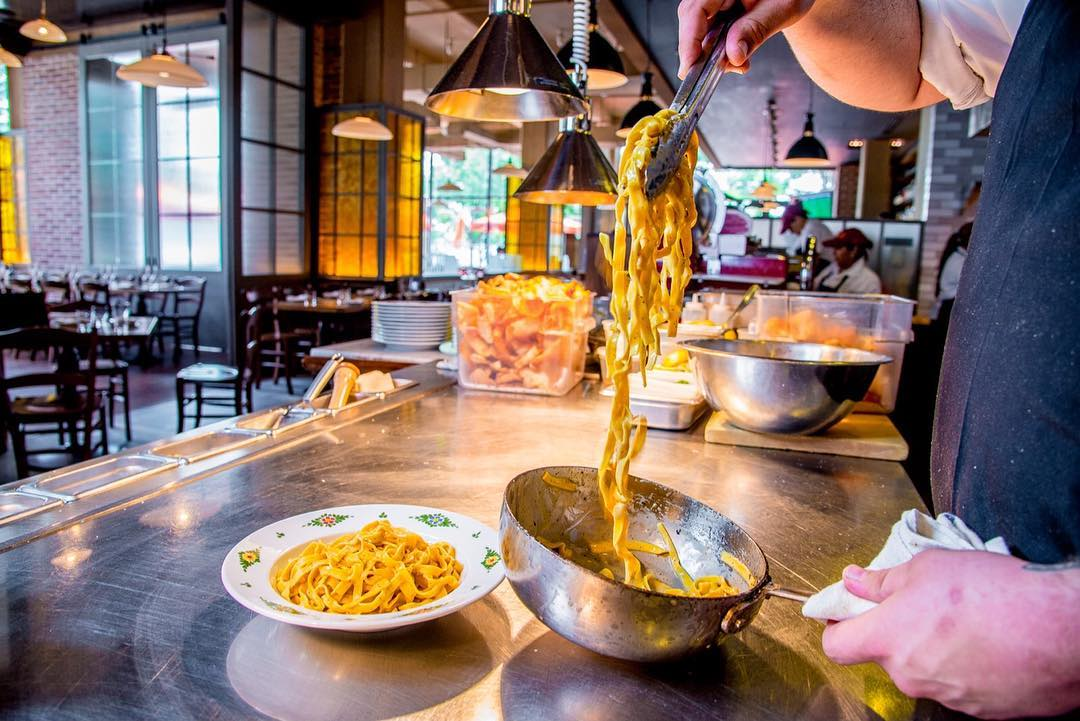 Fettuccini noodles being prepared at Osteria Morini restaurant