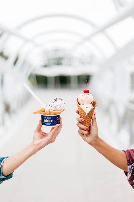 Hands holding ice cream cone and bowl from Ice Cream Jubilee