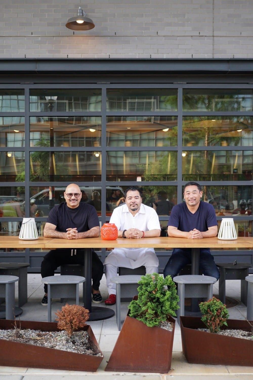 Partners Daisuke Utagawa, Chef Katsuya Fukushima, and Yama Jewayni outside their restaurant