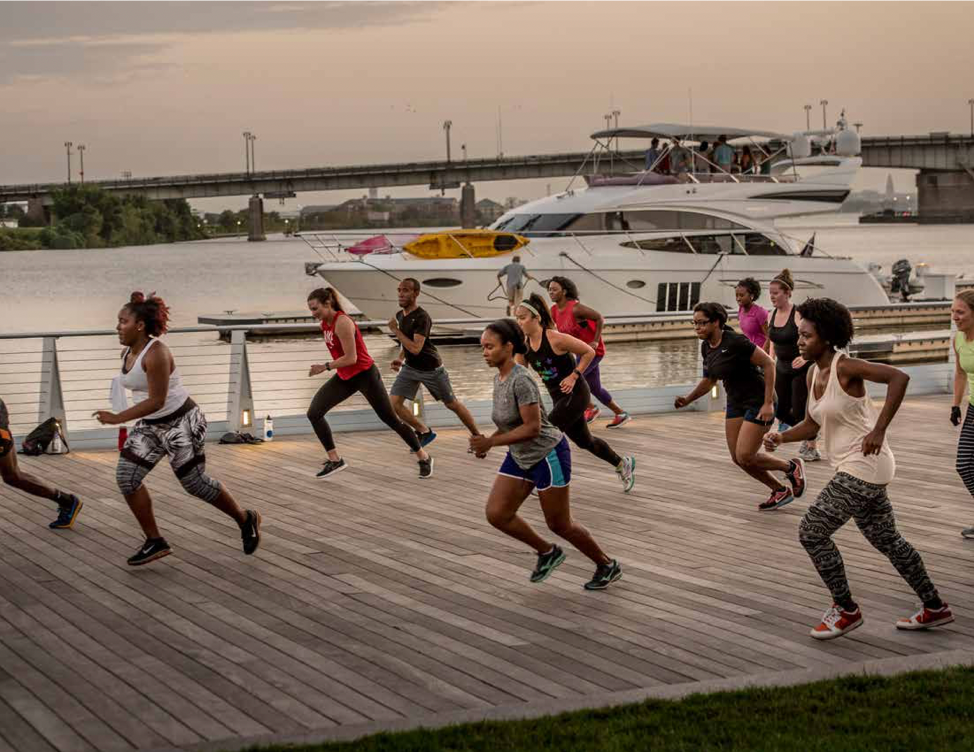 People running in running gear on the waterfront