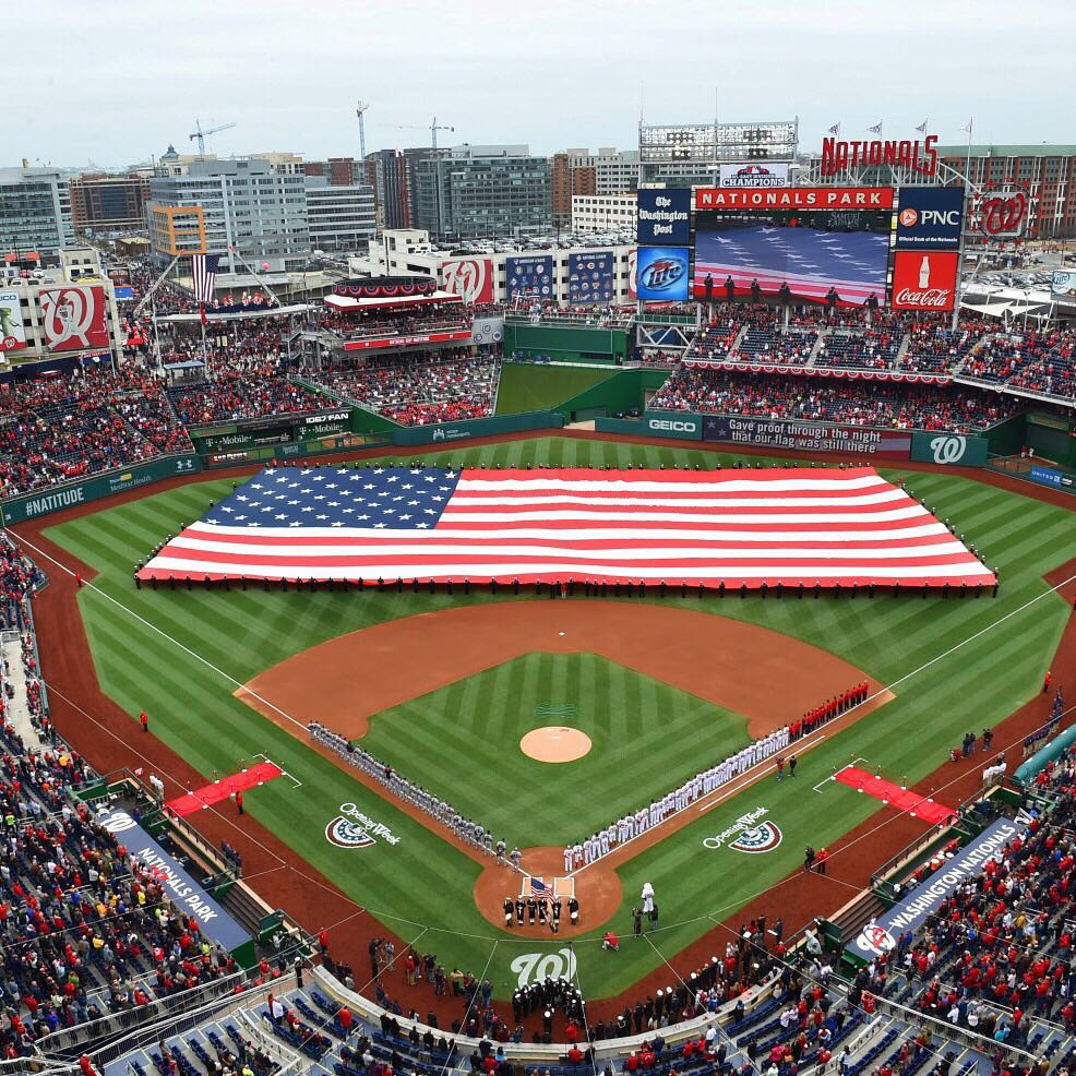 Aerial view of an American flag in Nationals Park during the national anthem