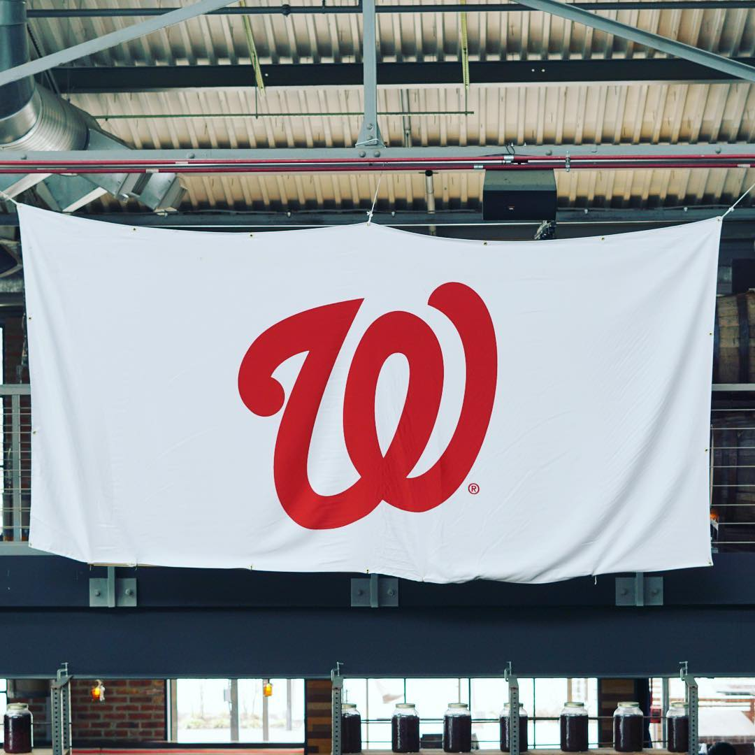 White Washington Nationals flag hanging from the rafters of a restaurant