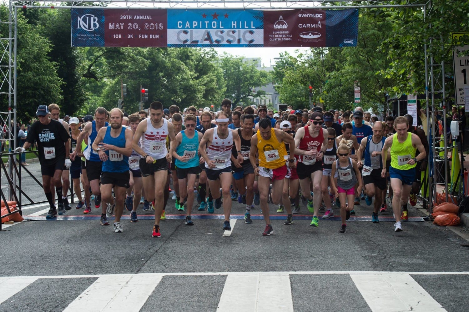 Runners begin a race on Capitol Hill