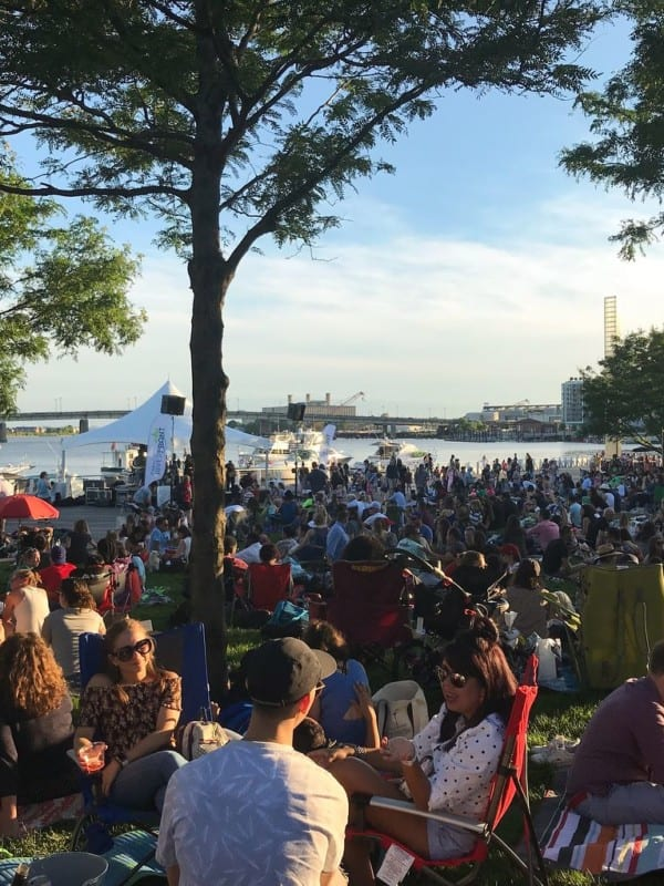 Crowded waterfront concert event in the summer at The Yards DC