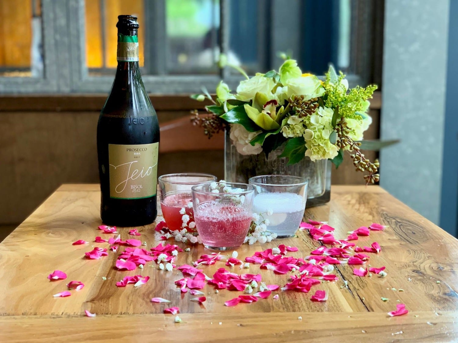 Glasses of rosé and prosecco with a bouquet of flowers at the Osteria Morini restaurant in Washington DC