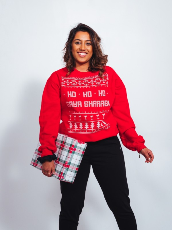 Woman in red Christmas sweater ho-ho-ho
