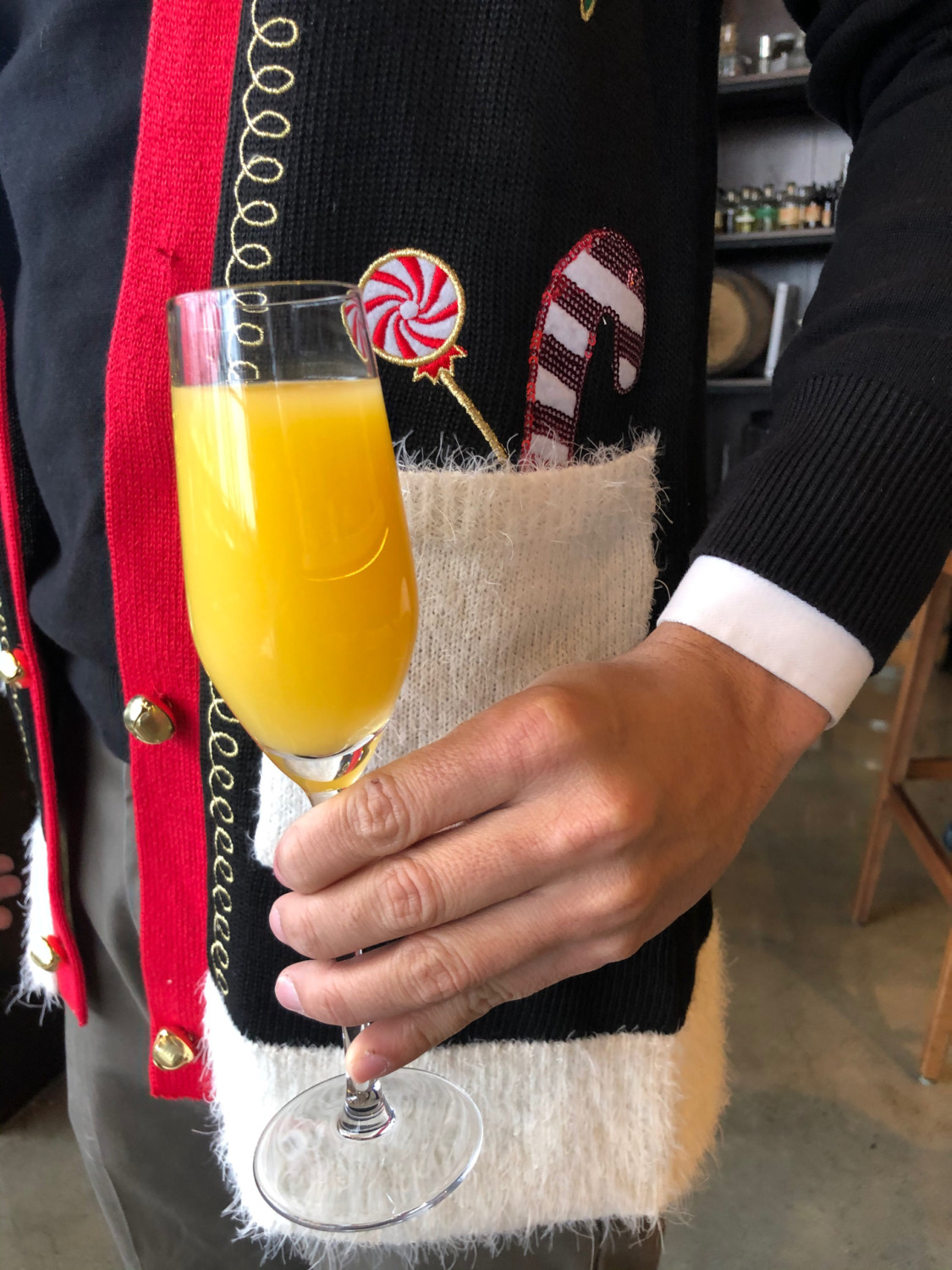 Woman holding champagne cocktail