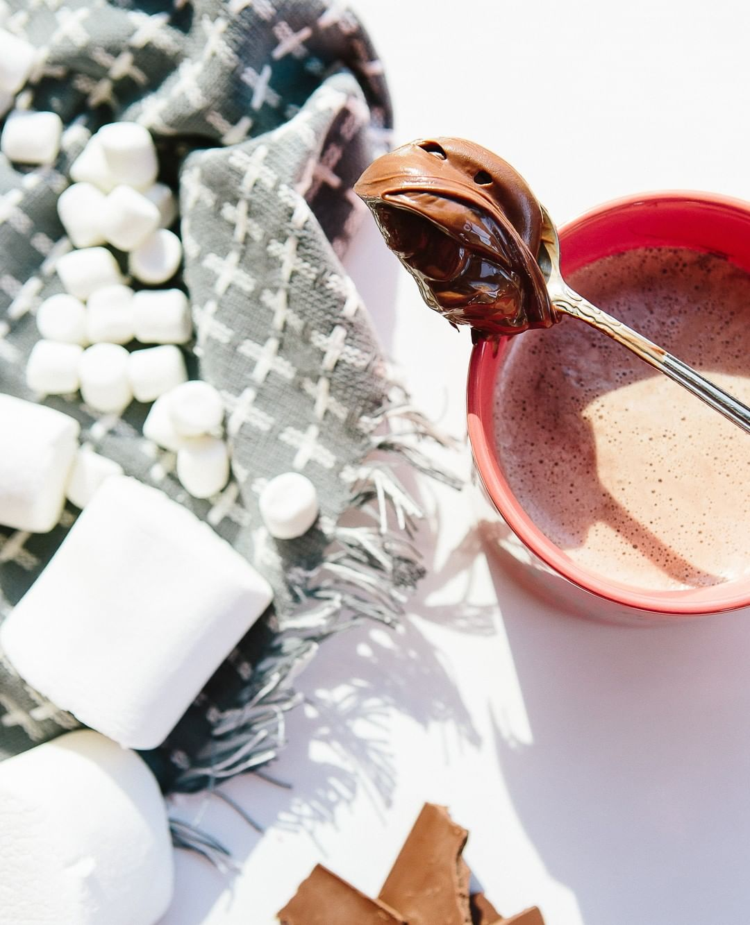 Hot chocolate with holiday toppings and marshmallows